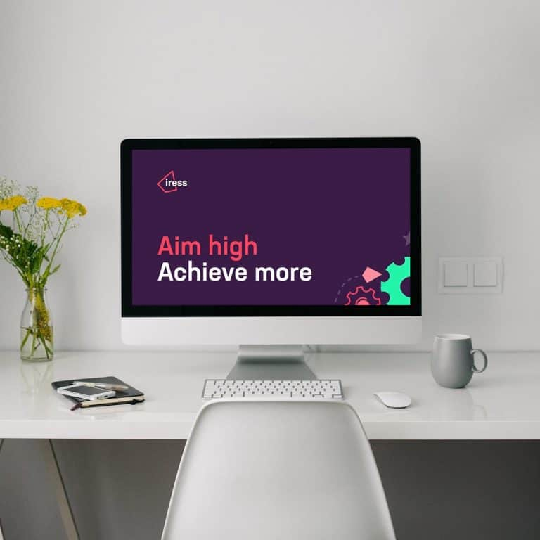 "Computer workstation with Iress logo and slogan ""Aim high, Achieve more"""